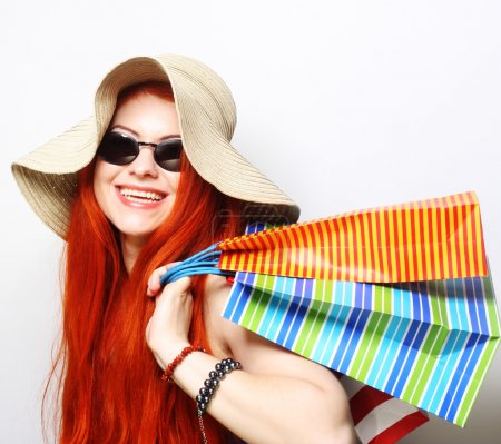 attractive redhair shopping woman