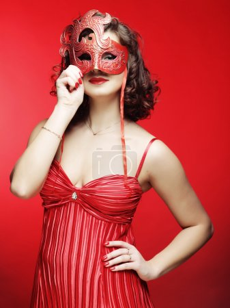 young woman with a red mysterious mask