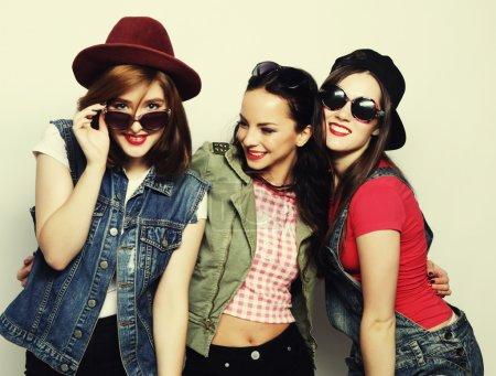 Three stylish sexy hipster girls best friends.