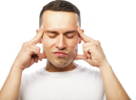 Attractive young man suffering of strong headache
