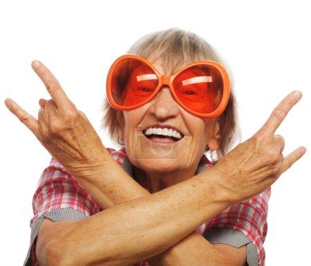 Senior woman wearing big sunglasses