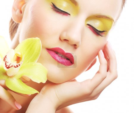 Photo for Close up portrait young woman with bright make up holding orchid - Royalty Free Image