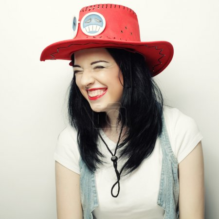 Photo for Portrait of Trendy Hipster Girl in Red Hat, studio shot - Royalty Free Image