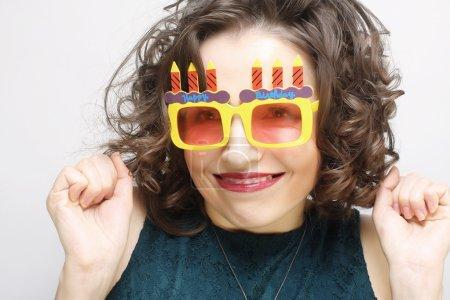 happy woman with big orange sunglasses