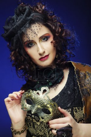 curly woman with mask. Carnaval visage.