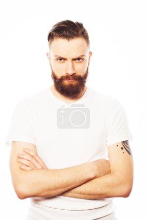 Stylish bearded man in white shirt.
