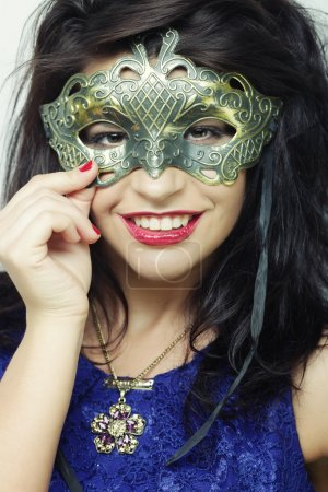 young woman with mysterious mask