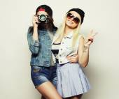 Two girls with cameras in hipster style