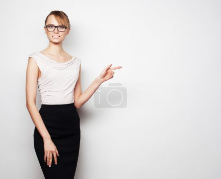 young business woman shows something