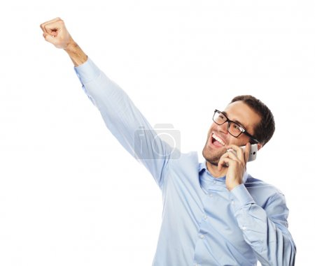 Successful gesturing business man with mobile