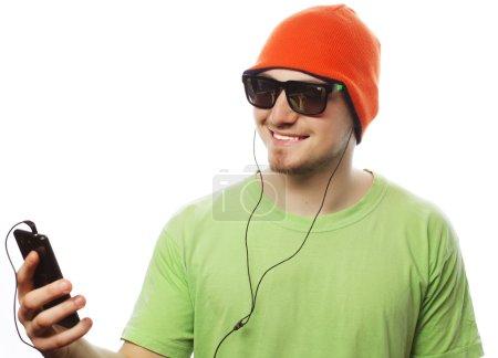 man listening music and using smartphone