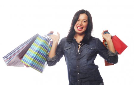 Happy brunette woman with shopping bags