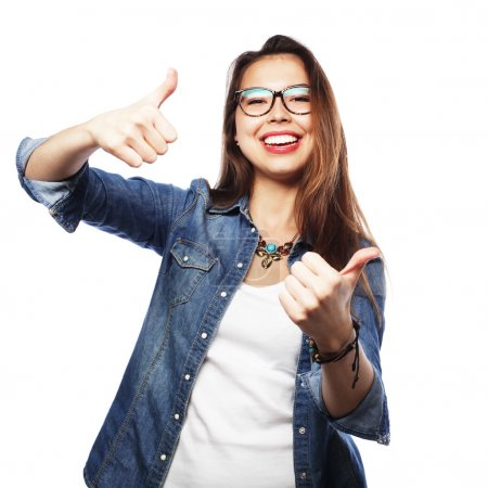Successful girl gives thumb up with two hands