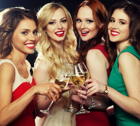 Photo for Group of partying girls clinking flutes with sparkling wine - Royalty Free Image