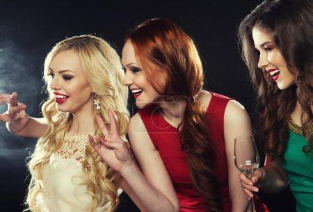 Photo for Four beautiful stylish girls singing karaoke at the club - Royalty Free Image