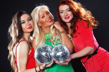 Photo for Party girls with disco ball, happy and smile. - Royalty Free Image