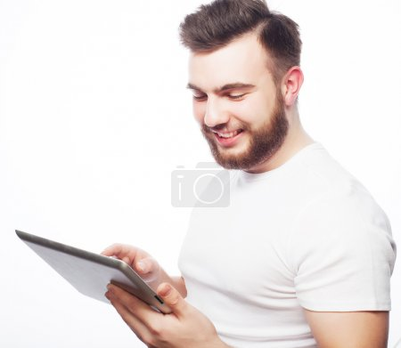Photo for Tehnology and lifestyle concept: young man wearing white t-shirt using a tablet computer - isolated over a white background - Royalty Free Image