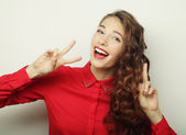 beautiful young woman showing thumbs up gesture