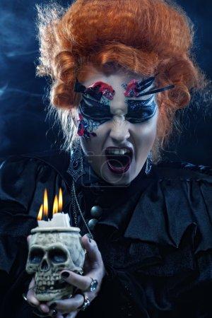 beautiful fantasy woman with skull. Halloween theme.