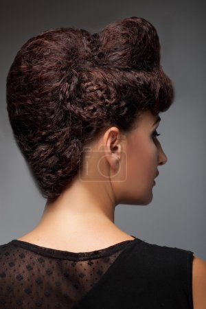 beautiful woman with stylish hairstyle and makeup