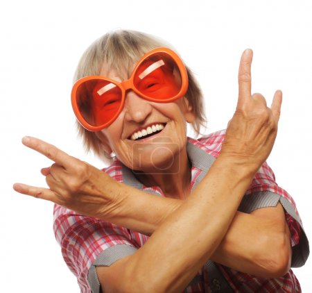 Senior woman wearing big sunglasses doing funky action