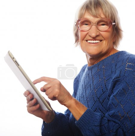 Senior happy woman using ipad