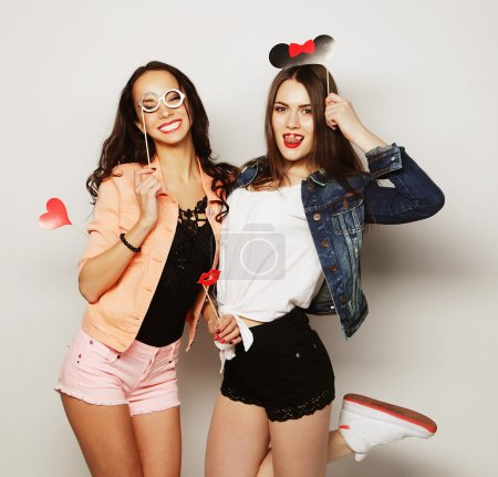 Photo for Two stylish sexy hipster girls best friends ready for party, over gray background - Royalty Free Image