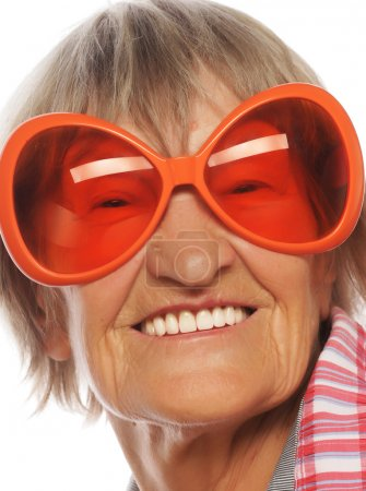 Senior happy woman wearing big sunglasses doing funky action