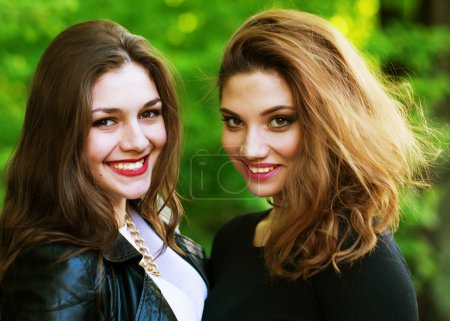 Teenage girls, having fun outdoor.