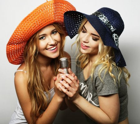 Two beauty girls with a microphone