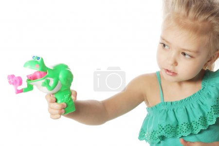 Photo for Portrait of funny lovely little girl blowing soap bubbles - Royalty Free Image