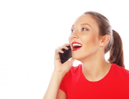 Woman using a mobile phone isolated on a white background