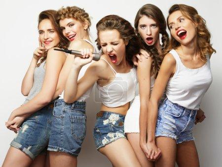 Photo for Group of  beautiful stylish hipster  girls singing karaoke - Royalty Free Image