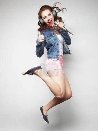 woman jumping and singing