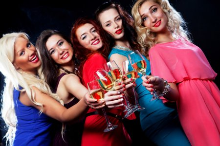 partying girls clinking flutes with sparkling wine