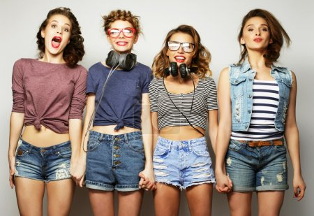 four stylish sexy hipster girls best friends