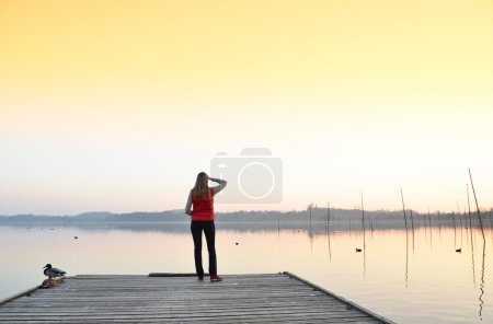 Girl on the wooden jetty.