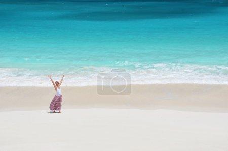 Girl on the desert beach