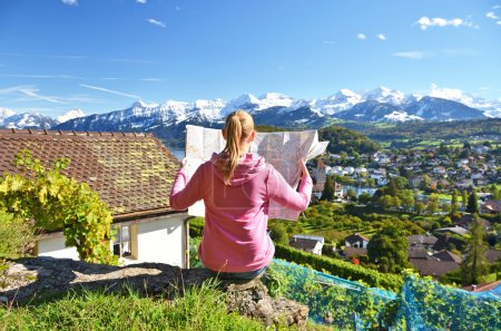 Girl looking to map in Switzerland