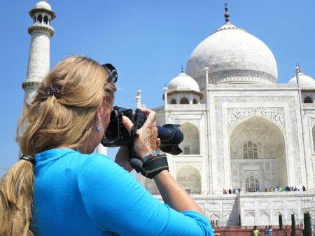Photo for Girl taking a shot of Taj Mahal. Agra, India - Royalty Free Image