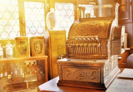 Vintage cash register in  pharmacy