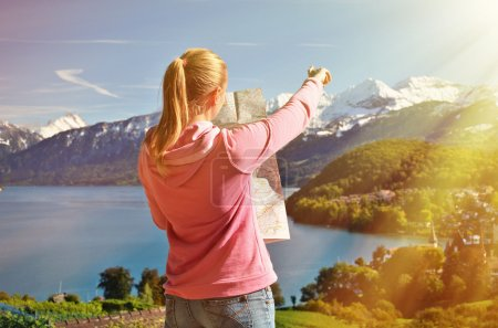 Girl looking to the map in Switzerland