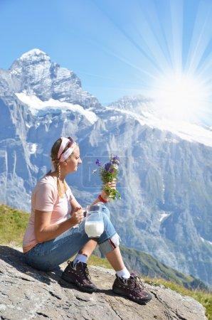 Girl against Swiss Alps
