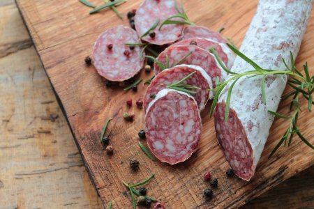 Italian salami sausage with pepper and rosemary he...