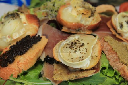 Photo for Goat cheese salad with tomato and egg plant caviar - Royalty Free Image