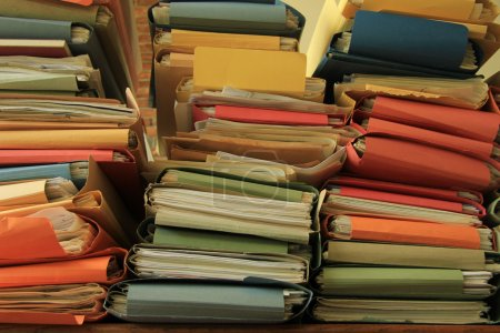 Photo for Stacked office files: pile of files in an office - Royalty Free Image