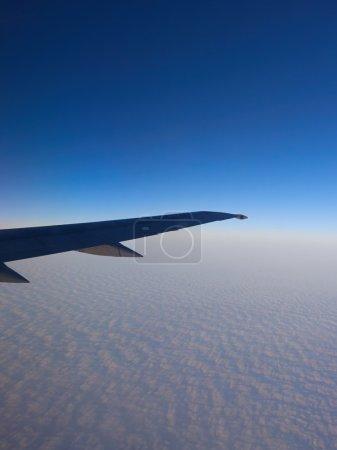 Sky  seen through window of an aircraft