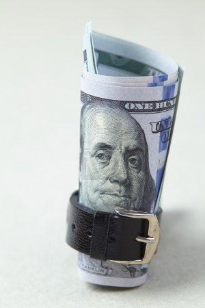 belted dollars stack