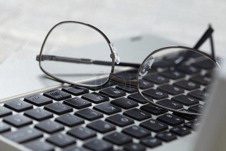 Eye glasses on keyboard