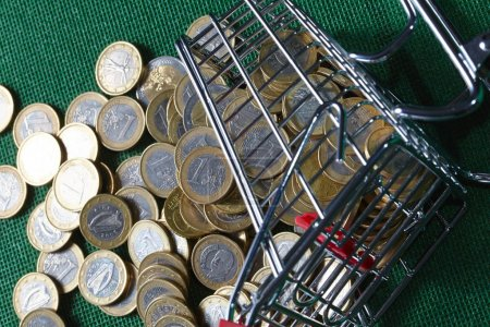 Coins in shopping basket